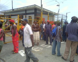 Workers in front the PWC site where the hotel is to be built