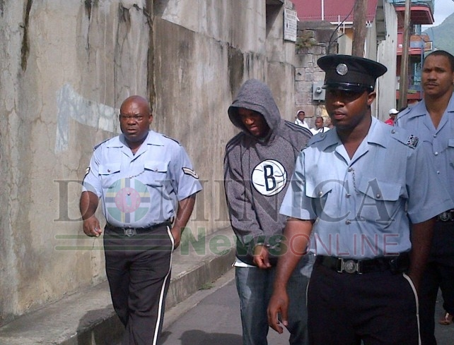 Seko being led to court before he was granted bail