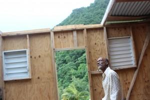 Joseph surveys the damage to his home