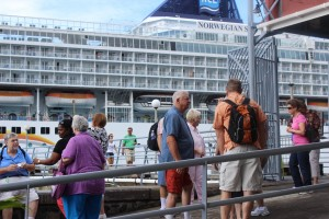 Visitors disembarking from a cruise ship in Dominica