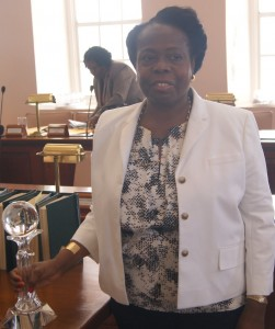 Jean Joseph poses with the award in parliament on Wednesday