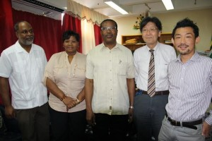 Hara, far right, poses with health and JICA officials