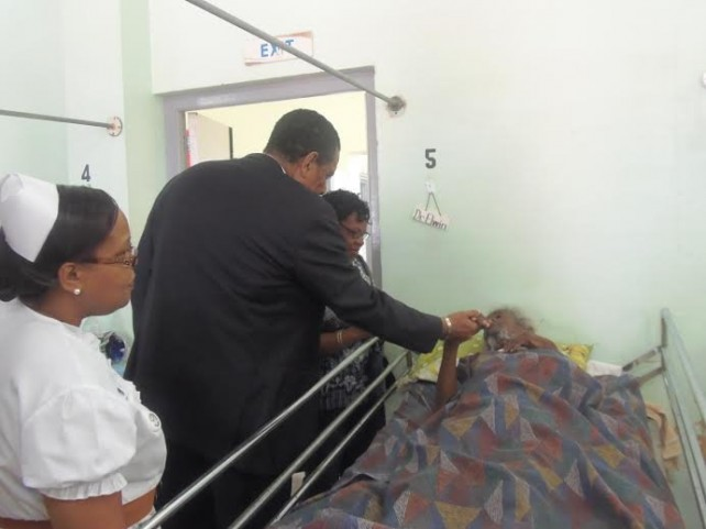 President Savarin greets a patient at the PMH