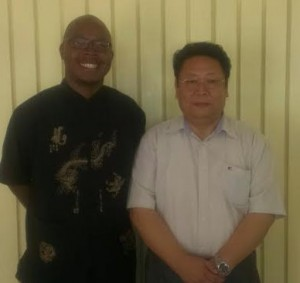 Douglas poses with Ambassador Li