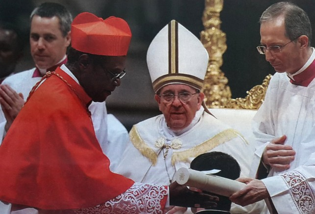 Cardinal Felix receives his appointment in Rome earlier this year while Pope Francis looks on