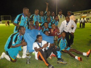 The victorious St. Lucia team displays trophy