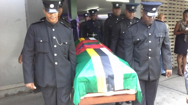 Matthew's flag draped coffin being carried by fellow police officers