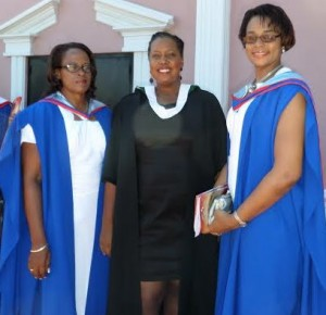 Masters degree recipients, Mrs. Helen Henry-Ferdinand and  Sarah Douglas-Perez (both MA English) with Officer-In-Charge, Kimone Joseph