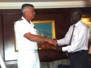 Captain of Insignia shakes hands with Hyacinth of Monday