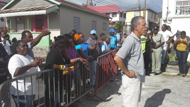 UWP supporters restrained by metal barricades outside Electoral Office