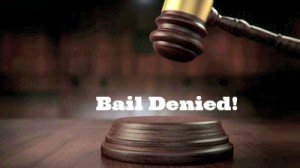 Customs officer charged with trafficking firearms, and other customs-related offenses, denied bail