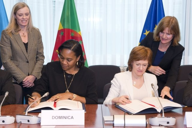 Dominica's Foreign Minister, Francine Baron, signs the agreement on Thursday