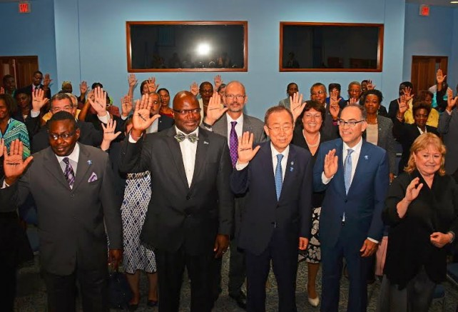 UN Secretary General Ban Ki-moon, flanked by (from left) Barbados Minister of Social Care Steven Blackett, Attorney General Adriel Brathwaite and UN Resident Coordinator Steve O'Malley take the #ENDviolence pledge