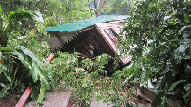 A collapsed cottage at the old Jungle Bay during the passage of Tropical Storm Erika