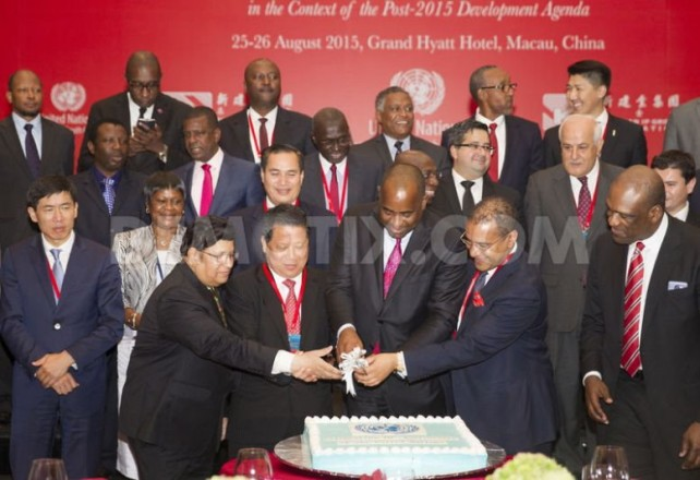 Chinese billionaire developer Mr Ng Lap Seng, Prime Minister of Dominica Roosevelt Skerrit, Ambassadors Francis Lorenzo of the Dominican Republic and John W Ashe of Antigua and Barbuda cut a UN adorned cake, in Macau, China. Photo: Demotix.com
