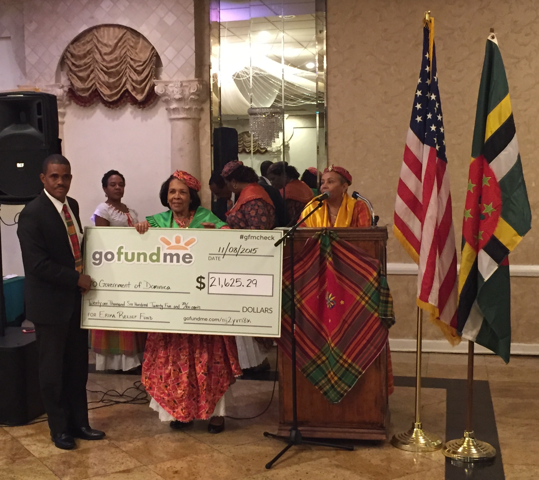 Minister Petter Saint Jean receives cheque from DARDA
