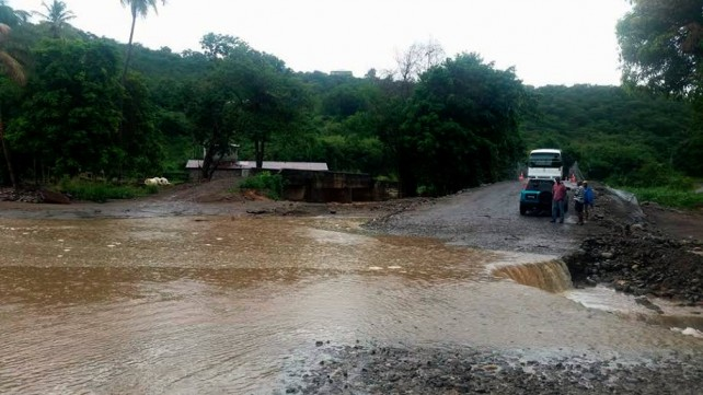 Approach to Bailey bridge at Macoucherie. All photos by Hector John