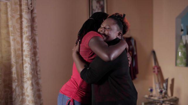 Stafanie and her surrogate mom share a hug
