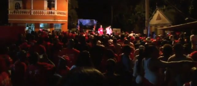 Video screenshot of jubilant DLP supporters after the victory