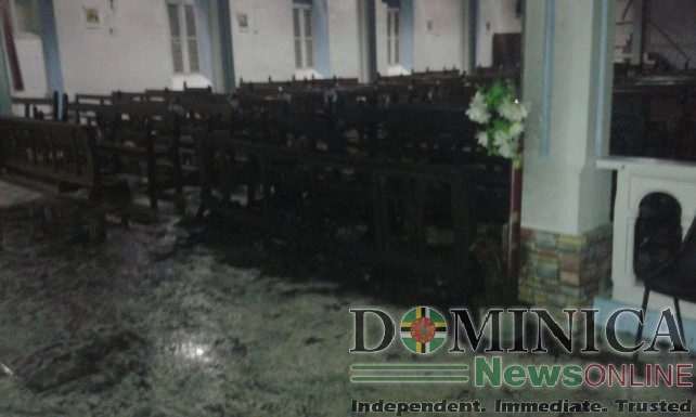 Several pews were damaged in the fire at the church in Pointe Michel
