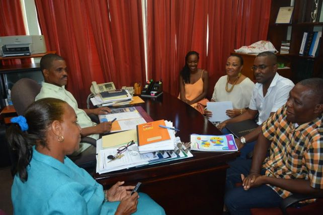 Officials from Guadeloupe and the Ministry of Education discuss the proposed project