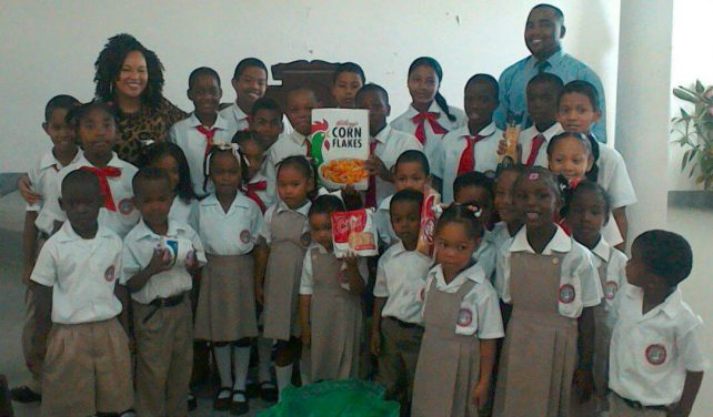 Students of the Lighthouse Academy with their donation
