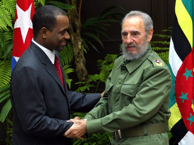Roosevelt Skerrit Prime Minister of Dominica, left, and Cuban President Fidel Castro shake hands Friday Feb.18, 2005 at the Revolutiuon Palace in Havana, Cuba.  Skerrit starts  today his second visit to the Island. (AP Photo/Jose Goitia)