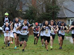 Participants compete for barrel of ale in wife-carrying race in UK