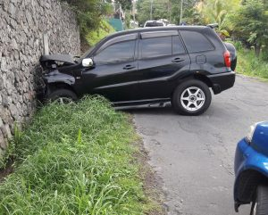Vehicle crashes into wall at Castle Comfort